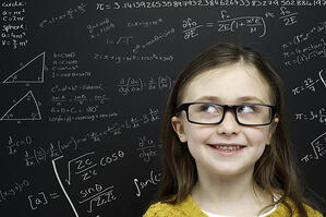 bigstock-Smart-Young-Girl-Stood-Infront-40334293